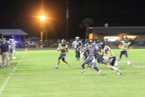 Neck and neck match for rivalry football game against Navarre