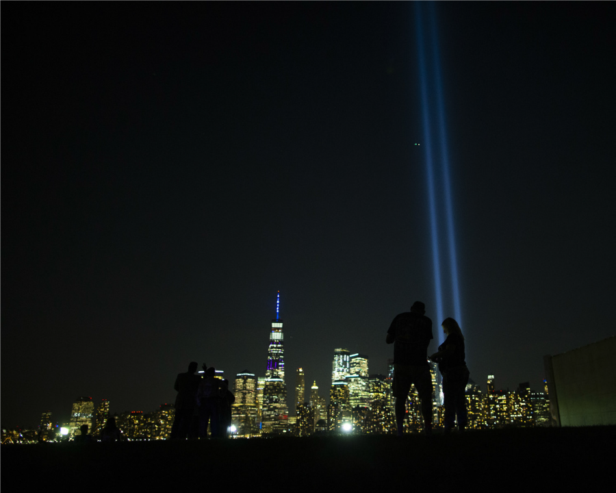 On the anniversary of 9/11, the tribute light shines to the sky where the Twin Towers once stood.