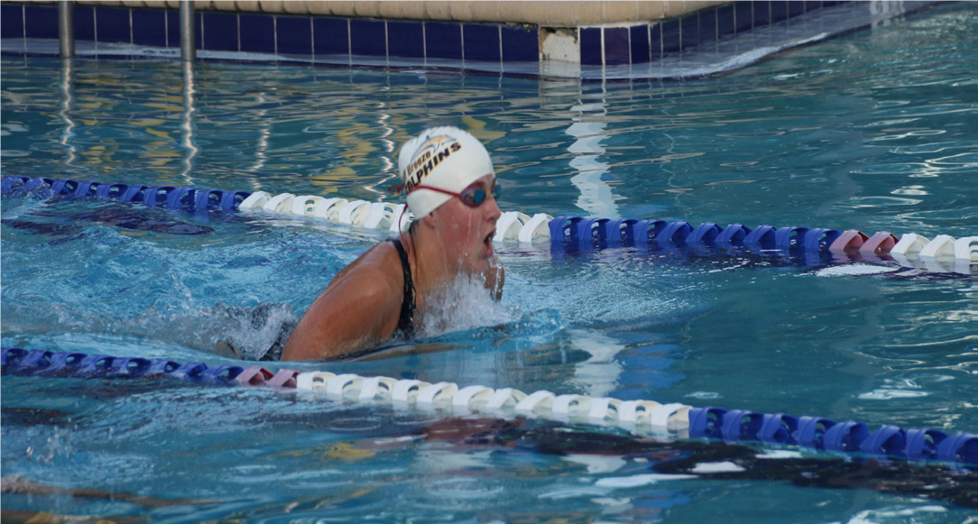 Senior Victoria Zembruski comes up for air while swimming the 100 meter breaststroke.