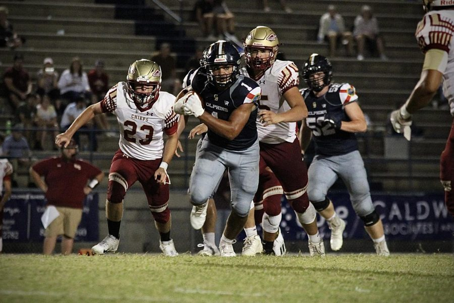 Gulf Breeze player runs the ball past Northview players on September 10